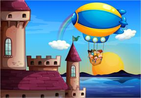 A floating balloon with kids going to the castle