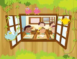 Students inside the classroom with birds at the window
