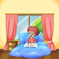 Un giovane ragazzo studia in camera da letto