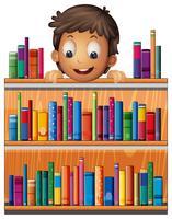 Un niño en la parte trasera de un estante de madera con libros.