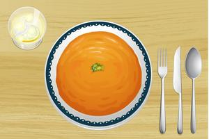An orange soup on a plate