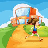 Una niña corriendo cerca de la escuela