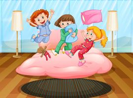 Tres niñas jugando en una fiesta de pijamas