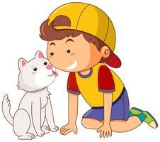 Pequeno gato lambendo o rosto do menino