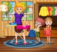 Mother ironing cloth for children