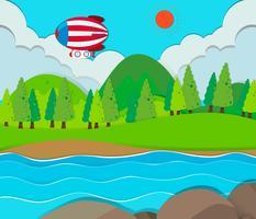 Globo volando sobre el rio