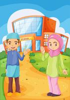 A male and a female Muslim in front of a school building