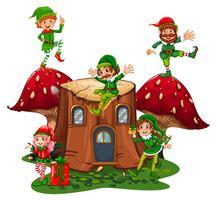 Muchos elfos en casa de troncos en el jardín