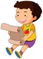 Glad pojke läsning papper