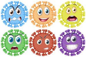 Unterschiedliche Gesichtsausdrücke auf rundem Gegenstand