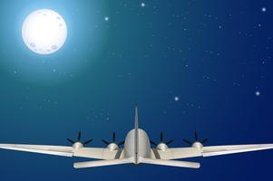 Een vliegtuig dat bij nacht vliegt