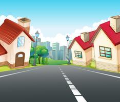 Escena de barrio con muchas casas a lo largo de la carretera.
