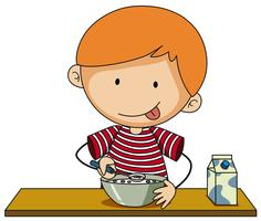 Kleiner Junge, der Getreide mit Milch isst