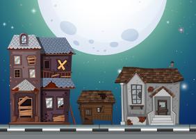 Drie oude huizen op straat 's nachts