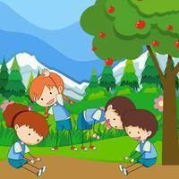 Quatro crianças exercem no parque