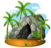 Escena de la naturaleza con cueva y cocoteros.