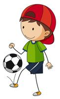 Liten pojke som spelar fotboll