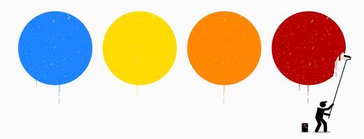 Målare målar fyra tomma cirklar på väggen med olika färger av blå, gul, orange och röd.