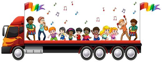 Children singing and dancing on the truck