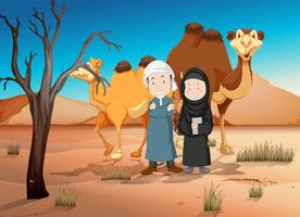 Two arab people and camels in desert