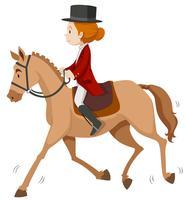 Donna che fa equitazione