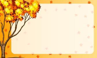 De herfstscène met boom en oranje bladeren