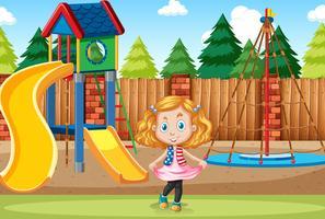 Flicka på lekplatsen