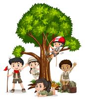 Boys and girls climbing tree
