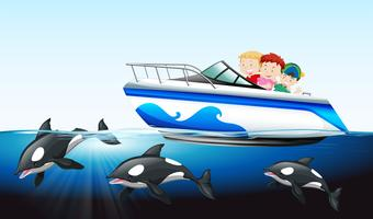 Children on boat and whale underwater