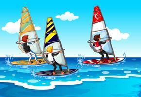 Le persone che fanno windsurf in mare