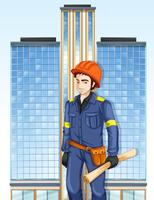 An engineer outside the tall building