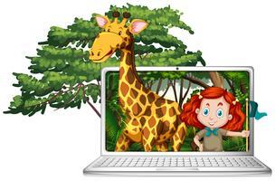 Ragazza e giraffa sullo schermo del computer