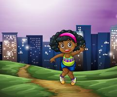 A young Black girl across the tall buildings in the city