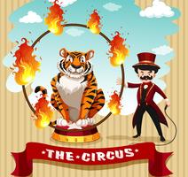 Tiger in fire hoop and ring master
