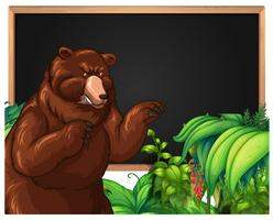 Brown bear and blackboard frame