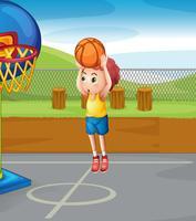 Liten pojke skjuter basket