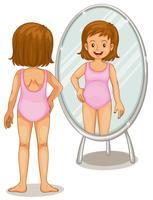 Mädchen, das Spiegel betrachtet