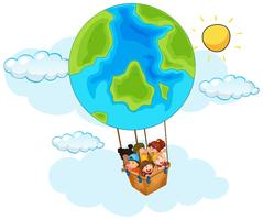 Happy children riding balloon with earth pattern in sky
