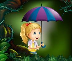 Tjej med paraply i skogen