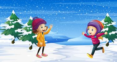 Two girls playing on the snow