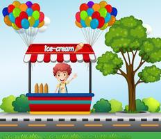 Junge, der Eiscreme im Park verkauft