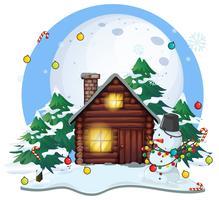 Holzhaus und Schneemann zu Weihnachten