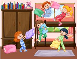 Flickor som har slumparti i sovrummet