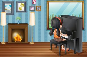 Chica tocando el piano en casa
