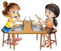 Two girls working on computer