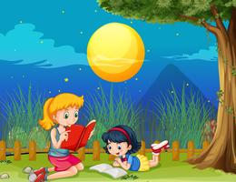 Two girls reading book on fullmoon night