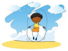 Niño saltando la cuerda en el día
