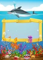 Diseño de cuadro con delfines bajo el agua.