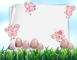 Conception de papier avec des papillons volant dans le jardin