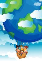 Bambini che cavalcano un grosso pallone